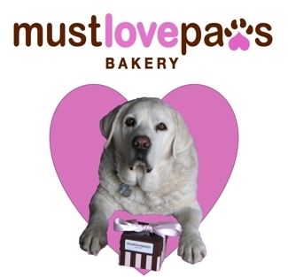 Joey with his Must Love Paws Bakery gift