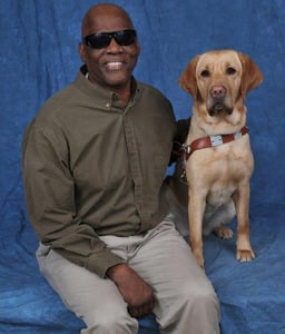 Cecil Williams and hero dog Orlando welcome new dog to the