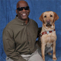 Cecil Williams and hero dog Orlando welcome new dog to the family