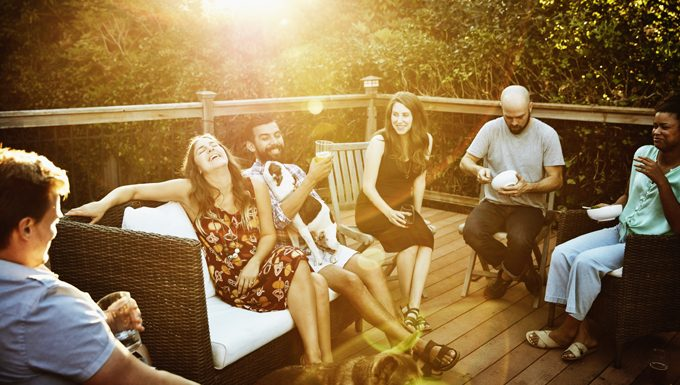 people having party on porch with dog