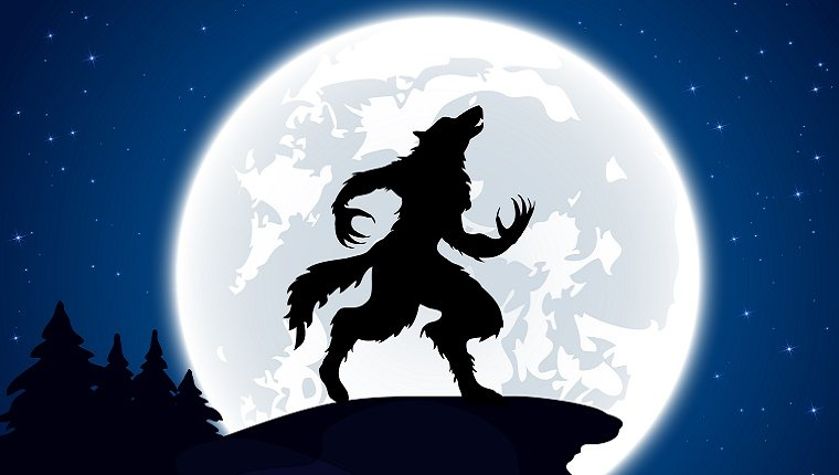 A werewolf in silhouette stands on a cliff and howls at the full moon behind him.