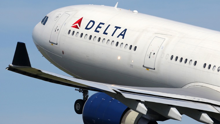 A Delta Airlines flight takes off.