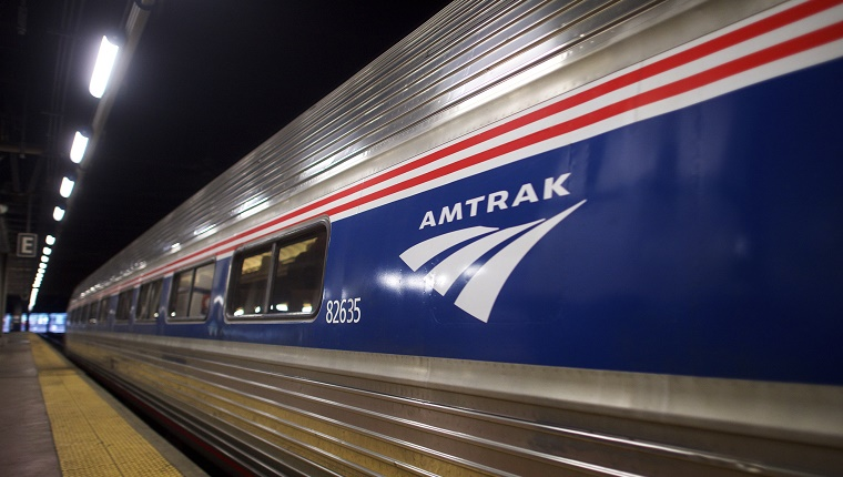 An Amtrak train sits inside a station.