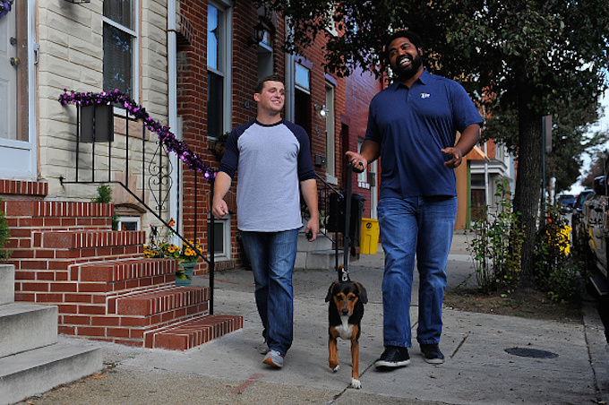 BALTIMORE, MD - OCTOBER 18: Baltimore Ravens Hall of Famer Jonathan Ogden teamed up with Miller Lite to surprise local fan Chase Loetz by taking a few things off his plate before watching the Ravens game together, including walking the dog on October 18, 2015 in Baltimore, Maryland. (Photo by Larry French/Getty Images for Miller Lite)