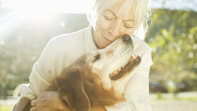 woman with senior dog