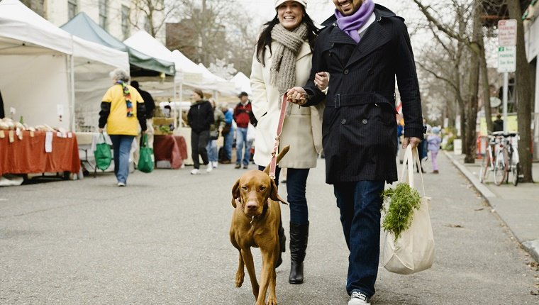 Couple with dog at farmer's market