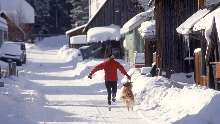 Woman running with dog, Breckenridge, CO
