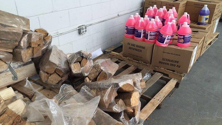 Firewood and antifreeze sits for sasle in front of Lowes Home Improvement in Bowie, Maryland, on January 20, 2016, as weather forecast predict an incoming blizzard to the area. / AFP / JIM WATSON (Photo credit should read JIM WATSON/AFP/Getty Images)