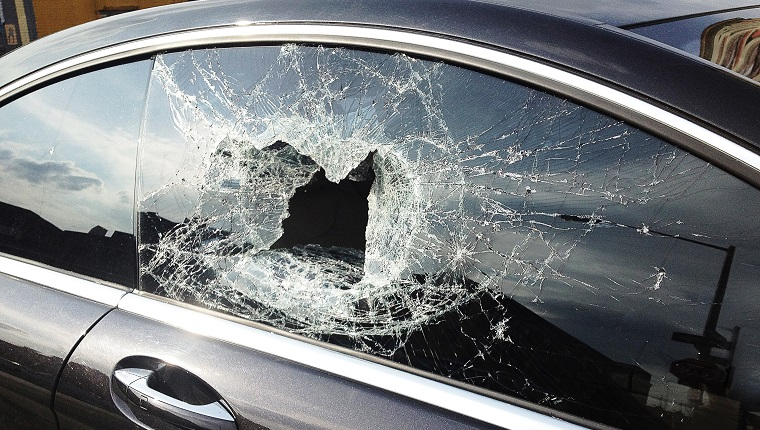 Smashed car window from recent theft in Brooklyn.