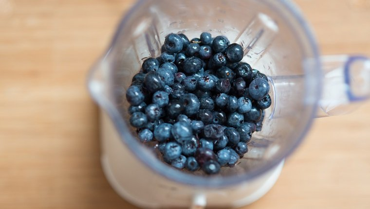 Ripe blueberry in a bowl of electric mixer, view from above