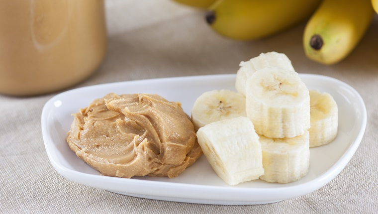 Early Morning Healthy Breakfast. Homemade peanut butter and bananas.